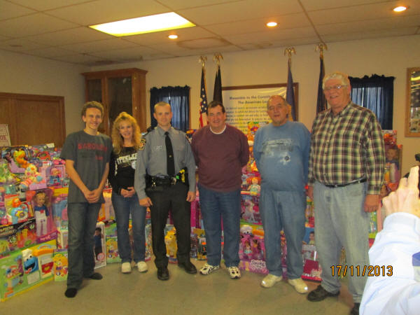Photo: Charles Kline,Lana Bender, , PSP Trooper Adam Borden, Bob Roberts President PGEC, organizer Jim Steinbeiser, and Don Wilhelm Chairman of the Board PGEC.
